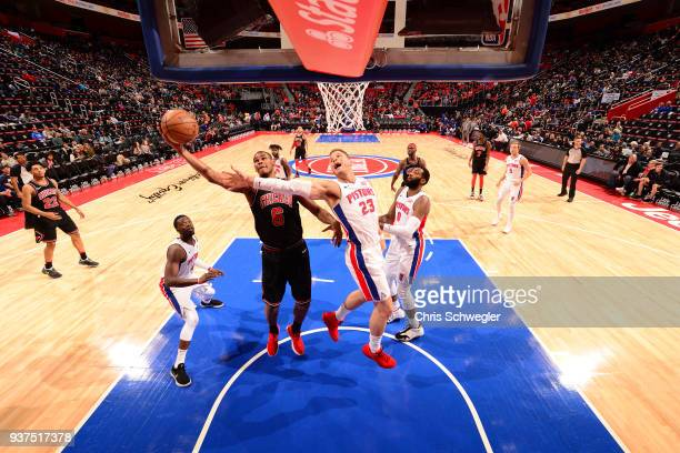 Blake Griffin of the Detroit Pistons reaches for the ball while Cristiano Felicio of the Chicago Bulls gets control on March 24 2018 at Little...