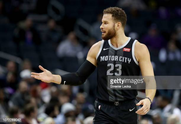 Blake Griffin of the Detroit Pistons reacts against the Charlotte Hornets during their game at Spectrum Center on December 12 2018 in Charlotte North...