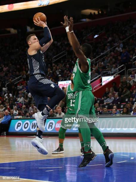 Blake Griffin of the Detroit Pistons shoots over Semi Ojeleye of the Boston Celtics during the second quarter of the game at Little Caesars Arena on...
