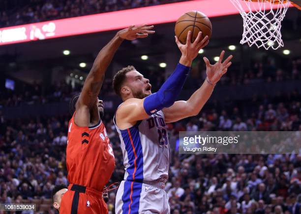 Blake Griffin of the Detroit Pistons shoots the ball as Kawhi Leonard of the Toronto Raptors defends during the first half of an NBA game at...