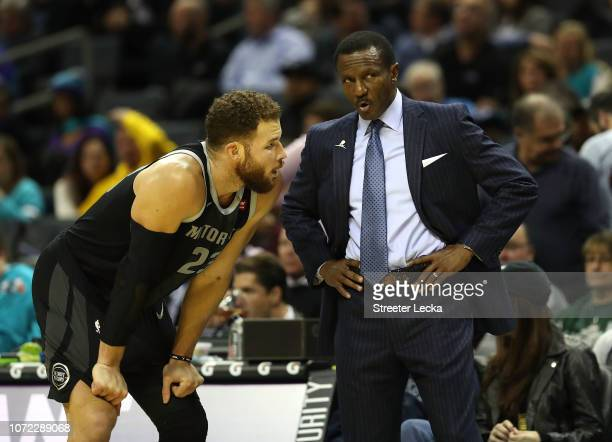 Blake Griffin of the Detroit Pistons talks to head coach Dwane Casey during their game against the Charlotte Hornets at Spectrum Center on December...