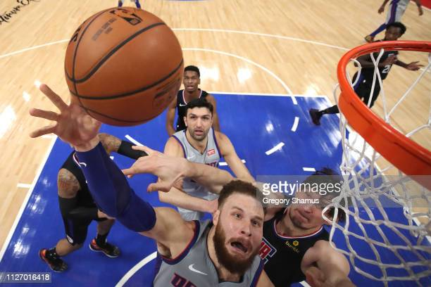 Blake Griffin of the Detroit Pistons triers to get a shot off past Boban Marjanovic of the LA Clippers during the first half at Little Caesars Arena...