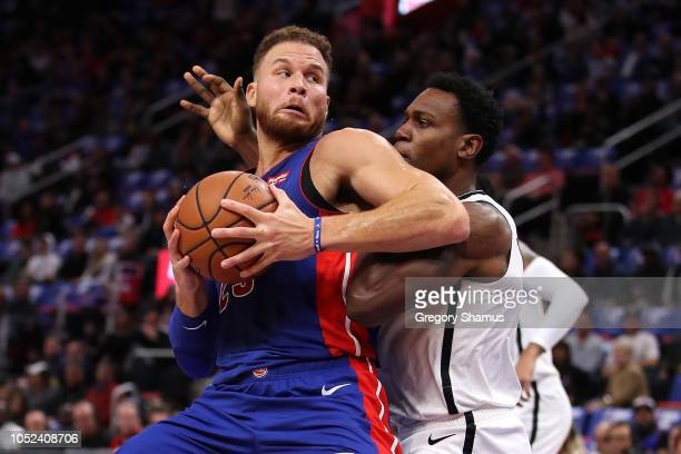 Blake Griffin of the Detroit Pistons tries to drive around Treveon Graham of the Brooklyn Nets in the first half during the home opener at Little...