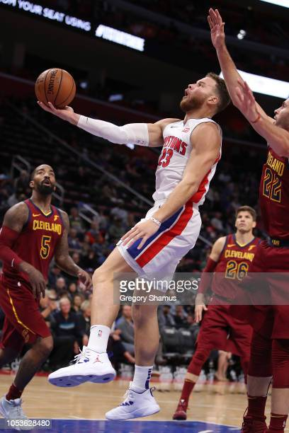 Blake Griffin of the Detroit Pistons tries to get a shot off in front of Larry Nance Jr. #22 of the Cleveland Cavaliers during the second half at...