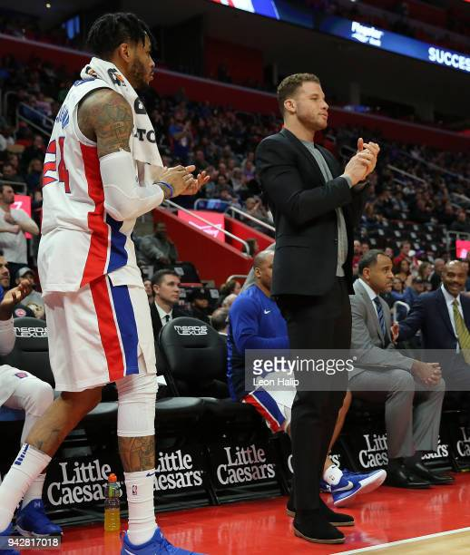 Blake Griffin of the Detroit Pistons watches the action from the bench during the game against the Dallas Mavericks at Little Caesars Arena on April...