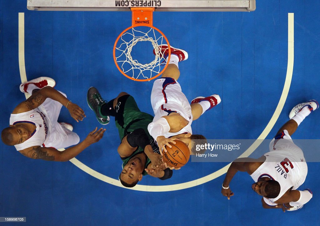 Blake Griffin #32 of the Los Angeles Clippers and Jared Sullinger #7 of the Boston Celtics go for a rebound in front of Chris Paul #3 and Caron Butler #5 during a 16-77 loss to the Clippers for 15 straight wins at Staples Center on December 27, 2012 in Los Angeles, California.