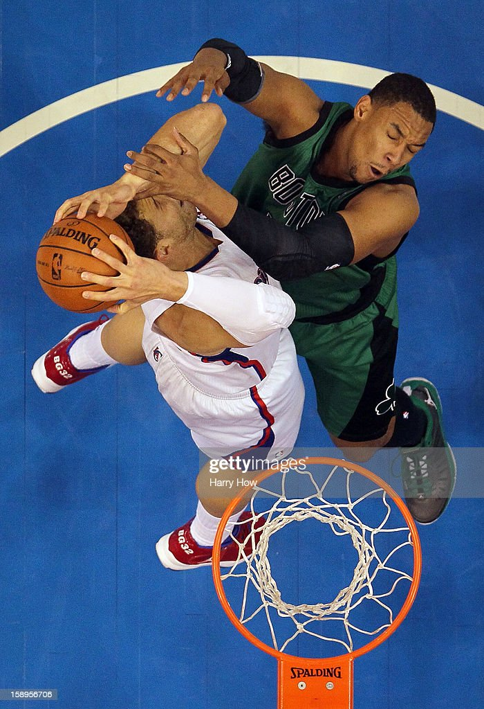 Blake Griffin #32 of the Los Angeles Clippers and Jared Sullinger #7 of the Boston Celtics go for a rebound during a 16-77 loss to the Clippers for 15 straight wins at Staples Center on December 27, 2012 in Los Angeles, California.