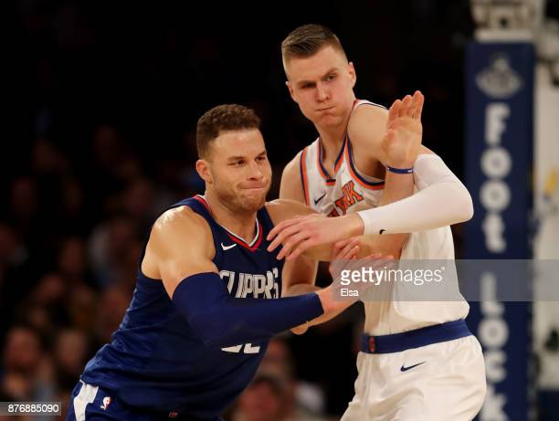 Blake Griffin of the Los Angeles Clippers and Kristaps Porzingis of the New York Knicks fight for position in the second half at Madison Square...
