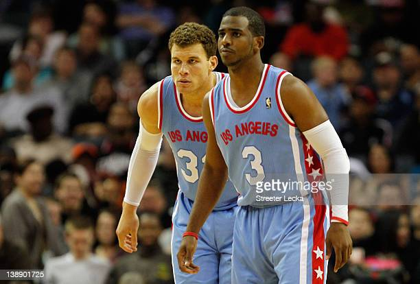 Blake Griffin of the Los Angeles Clippers and teammate Chris Paul prepare to play defense against the Charlotte Bobcats during their game at Time...