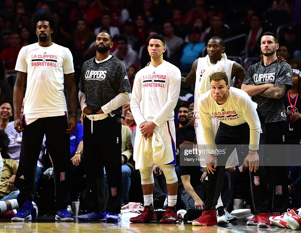 Blake Griffin #32 of the Los Angeles Clippers and teammates watch as the Toronto Raptors take the lead late in the fourth quarter during a preseason game at Staples Center on October 5, 2016 in Los Angeles, California.