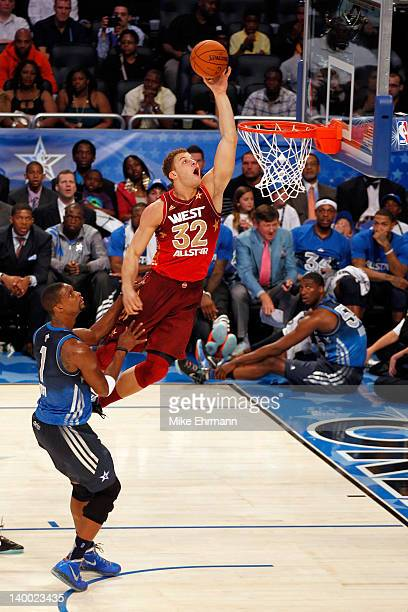 Blake Griffin of the Los Angeles Clippers and the Western Conference attempts a dunk against Chris Bosh of the Miami Heat and the Eastern Conference...