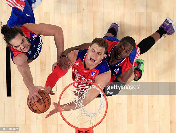 Blake Griffin of the Los Angeles Clippers and the Western Conference is grabbed by Dwyane Wade of the Miami Heat and the Eastern Conference and...