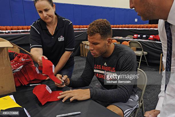 Blake Griffin of the Los Angeles Clippers autographs balls during media day at the Los Angeles Clippers Training Center on September 25 2015 in Playa...