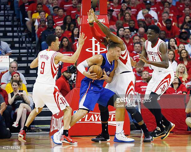 Blake Griffin of the Los Angeles Clippers battles for position with Pablo Prigioni Josh Smith and Clint Capela of the Houston Rockets during Game One...