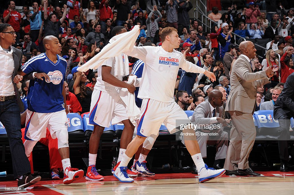 Blake Griffin #32 of the Los Angeles Clippers celebrates from the sideline as his teammates play in the fourth quarter against the Miami Heat at the Staples Center on November 14, 2012 in Los Angeles, California.