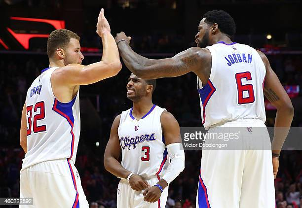 Blake Griffin of the Los Angeles Clippers celebrates with teammates Chris Paul and DeAndre Jordan after a scoring play in the second half during the...