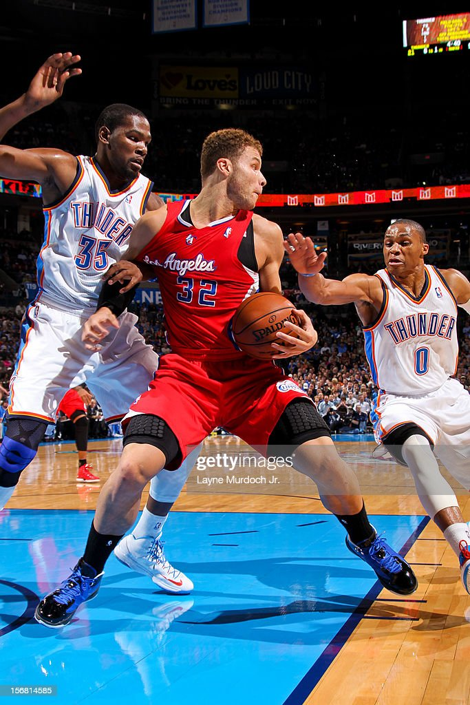 Blake Griffin #32 of the Los Angeles Clippers controls the ball against Russell Westbrook #0 and Kevin Durant #35 of the Oklahoma City Thunder on November 21, 2012 at the Chesapeake Energy Arena in Oklahoma City, Oklahoma.