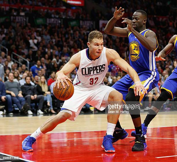 Blake Griffin of the Los Angeles Clippers dribbles the ball against Draymond Green of the Golden State Warriors during a game at Staples Center on...