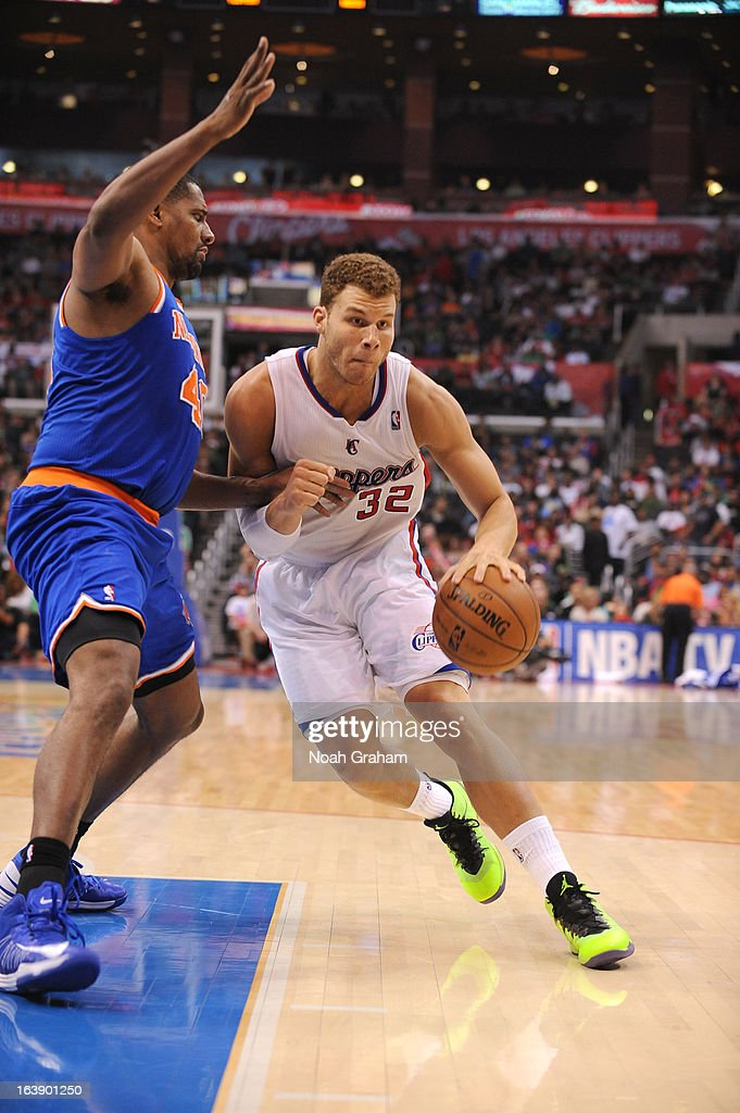Blake Griffin #32 of the Los Angeles Clippers drives under pressure during the game between the Los Angeles Clippers and the New York Knicks at Staples Center on March 17, 2013 in Los Angeles, California.