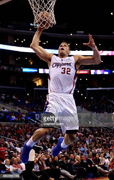 Blake Griffin of the Los Angeles Clippers dunks against the Milwaukee Bucks at Staples Center on March 24 2014 in Los Angeles California The Clippers...