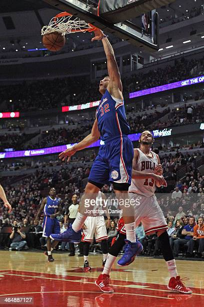 Blake Griffin of the Los Angeles Clippers dunks over Joakim Noah of the Chicago Bulls at the United Center on January 24 2014 in Chicago Illinois...