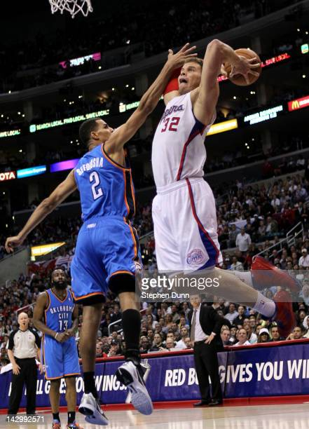 Blake Griffin of the Los Angeles Clippers dunks over Thabo Sefolosha of the Oklahoma City Thunder at Staples Center on April 16 2012 in Los Angeles...
