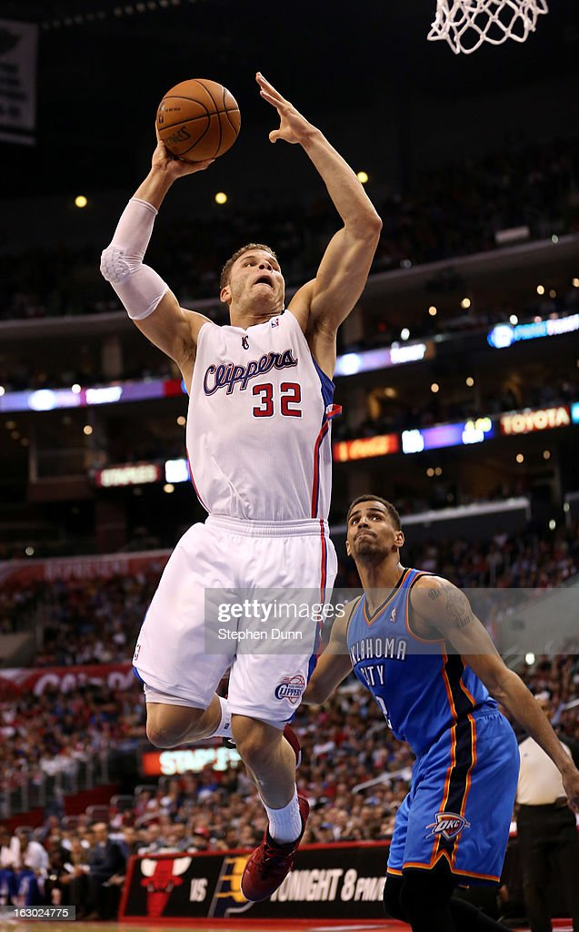 Blake Griffin #32 of the Los Angeles Clippers dunks over Thabo Sefolosha #2 of the Oklahoma City Thunder at Staples Center on March 3, 2013 in Los Angeles, California. The Thunder won 108-104.