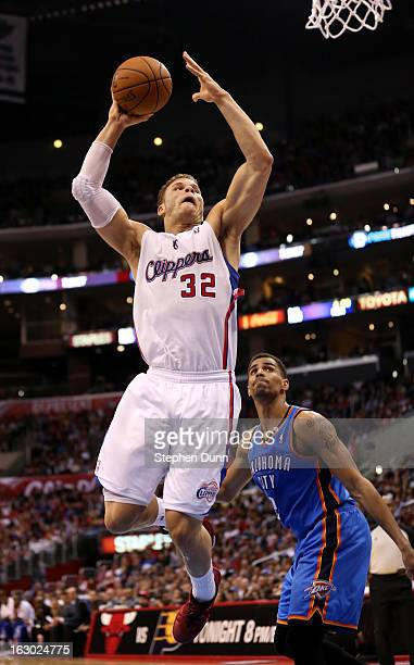 Blake Griffin of the Los Angeles Clippers dunks over Thabo Sefolosha of the Oklahoma City Thunder at Staples Center on March 3 2013 in Los Angeles...