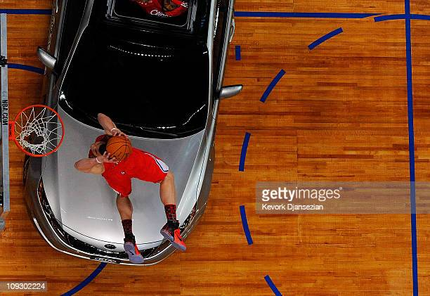 Blake Griffin of the Los Angeles Clippers dunks the ball over a car in the final round of the Sprite Slam Dunk Contest apart of NBA AllStar Saturday...