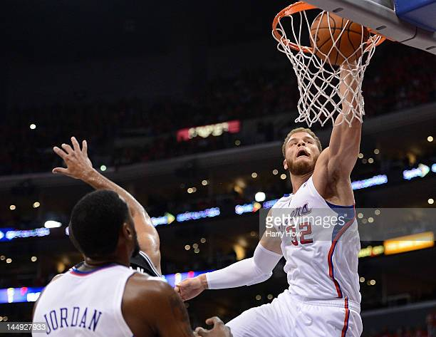 Blake Griffin of the Los Angeles Clippers dunks the ball over Tim Duncan of the San Antonio Spurs in the third quarter in Game Four of the Western...