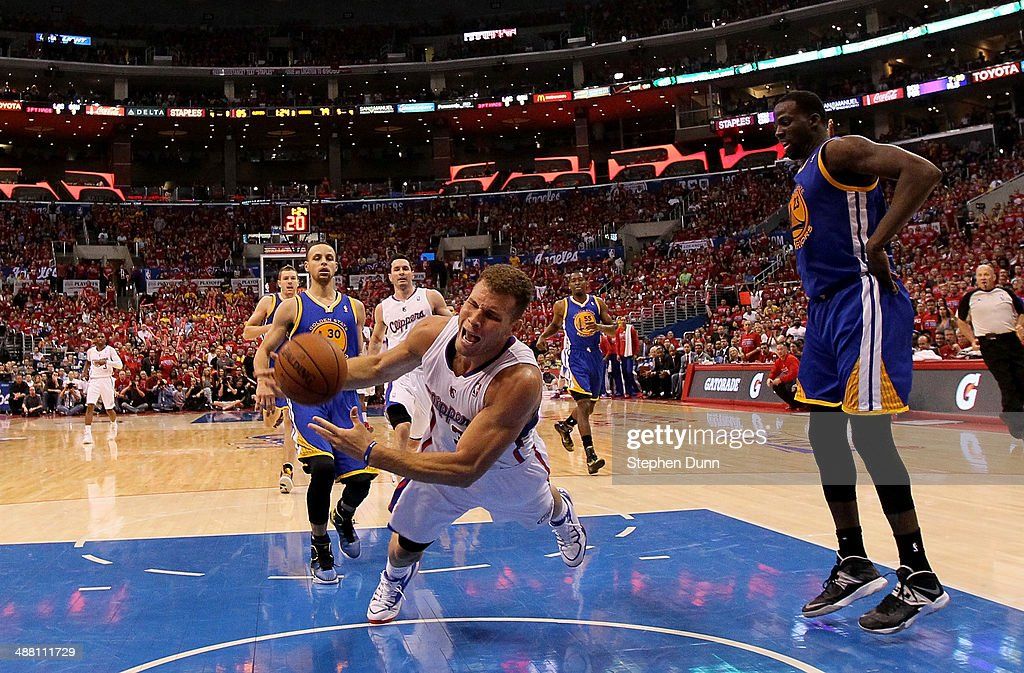 Blake Griffin #32 of the Los Angeles Clippers falls to the floor against the Golden State Warriors in Game Seven of the Western Conference Quarterfinals during the 2014 NBA Playoffs at Staples Center on May 3, 2014 in Los Angeles, California. The Clippers won 126-121 to win the series four games to three.
