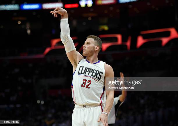 Blake Griffin of the Los Angeles Clippers follows through after scoring a threepoint basket for his 10000th career point against the Los Angeles...