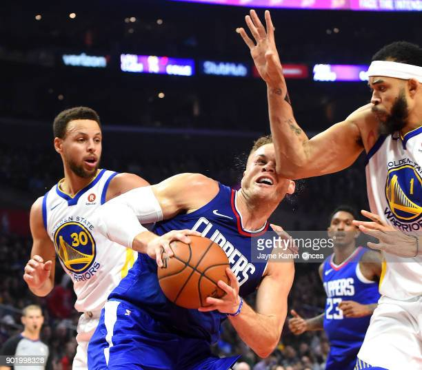 Blake Griffin of the Los Angeles Clippers gets hit with an elbow from JaVale McGee of the Golden State Warriors as he was driving to the basket in...