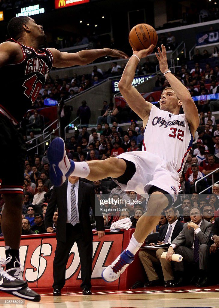 Blake Griffin #32 of the Los Angeles Clippers gets off a shot as he falls after being fouled by Kurt Thomas #40 of the Chicago Bulls at Staples Center on February 2, 2011 in Los Angeles, California. The Bulls won 106-88.