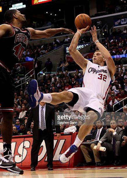 Blake Griffin of the Los Angeles Clippers gets off a shot as he falls after being fouled by Kurt Thomas of the Chicago Bulls at Staples Center on...