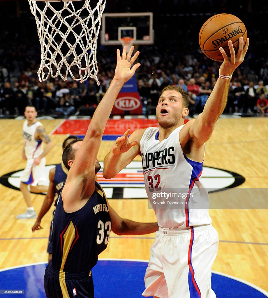 Blake Griffin #32 of the Los Angeles Clippers goes for a layup against Ryan Anderson #33 of the New Orleans Pelicans during the first half of the basketball game at Staples Center November 27, 2015, in Los Angeles, California.