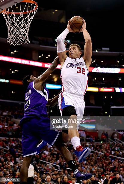 Blake Griffin of the Los Angeles Clippers goes up for a dunk on a lob play over John Salmons of the Sacramento Kings at Staples Center on December 21...