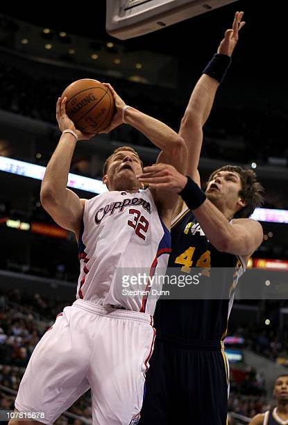 Blake Griffin of the Los Angeles Clippers goes up for a shot against Kyrylo Fesenko of the Utah Jazz at Staples Center on December 29 2010 in Los...
