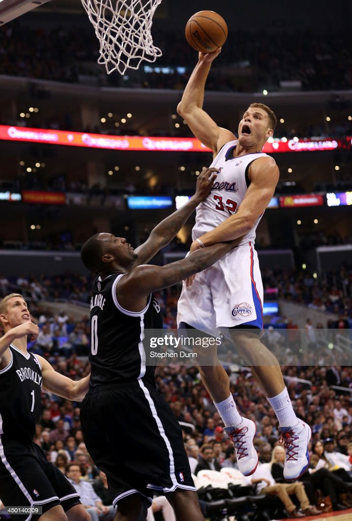 Blake Griffin #32 of the Los Angeles Clippers goes up for a shot and picks up a foul from Andray Blatche #0 of the Brooklyn Nets at Staples Center on November 16, 2013 in Los Angeles, California. The Clippers won 110-103.