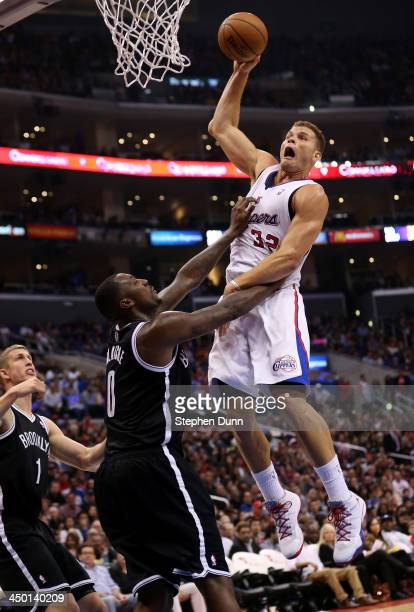 Blake Griffin of the Los Angeles Clippers goes up for a shot and picks up a foul from Andray Blatche of the Brooklyn Nets at Staples Center on...