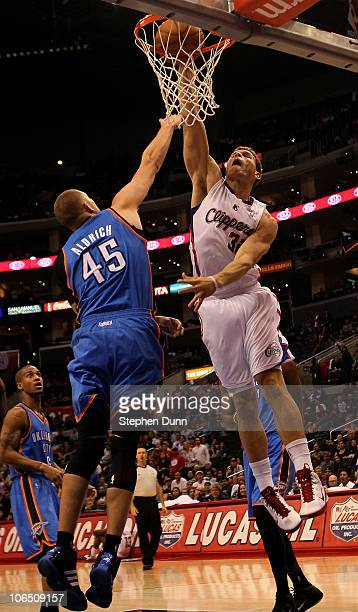 Blake Griffin of the Los Angeles Clippers goes up for a shot over Cole Aldrich of the Oklahoma City Thunder at Staples Center on November 3 2010 in...