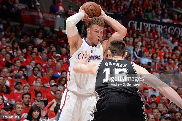 Blake Griffin of the Los Angeles Clippers handles the ball against Aron Baynes of the San Antonio Spurs in Game One of the Western Conference...