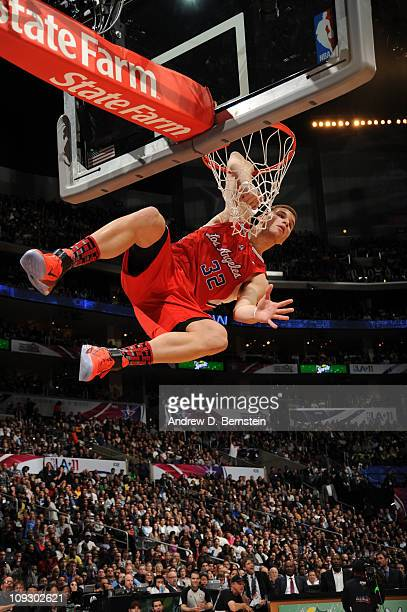 Blake Griffin of the Los Angeles Clippers hangs on the rim from his elbow after a dunk during the Sprite Slam Dunk Contest at Staples Center on...