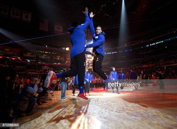 Blake Griffin of the Los Angeles Clippers high fives teammate DeAndre Jordan after he is introduced against the Memphis Grizzlies at Staples Center...
