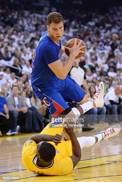 Blake Griffin of the Los Angeles Clippers is called for a charge on Draymond Green of the Golden State Warriors during the first quarter at ORACLE...