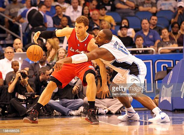 Blake Griffin of the Los Angeles Clippers is guarded by Glen Davis of the Orlando Magic during the game at Amway Center on February 6 2012 in Orlando...