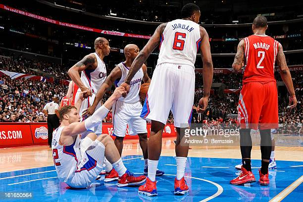 Blake Griffin of the Los Angeles Clippers is helped up by teammates Caron Butler Chauncey Billups and DeAndre Jordan while playing against the...