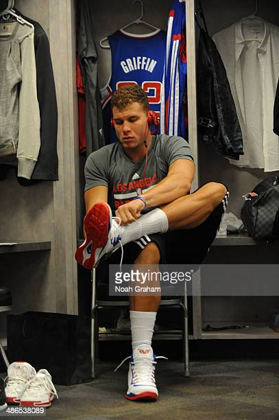 Blake Griffin of the Los Angeles Clippers laces up his shoes before facing the Golden State Warriors in Game Three of the Western Conference...