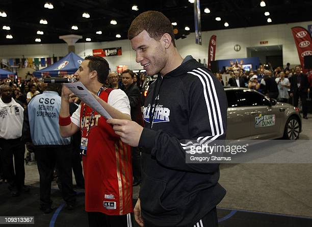 Blake Griffin of the Los Angeles Clippers looks at a photo of his dunk over of a Kia Optima during Sprite Slam Dunk Contest at Jam Session presented...