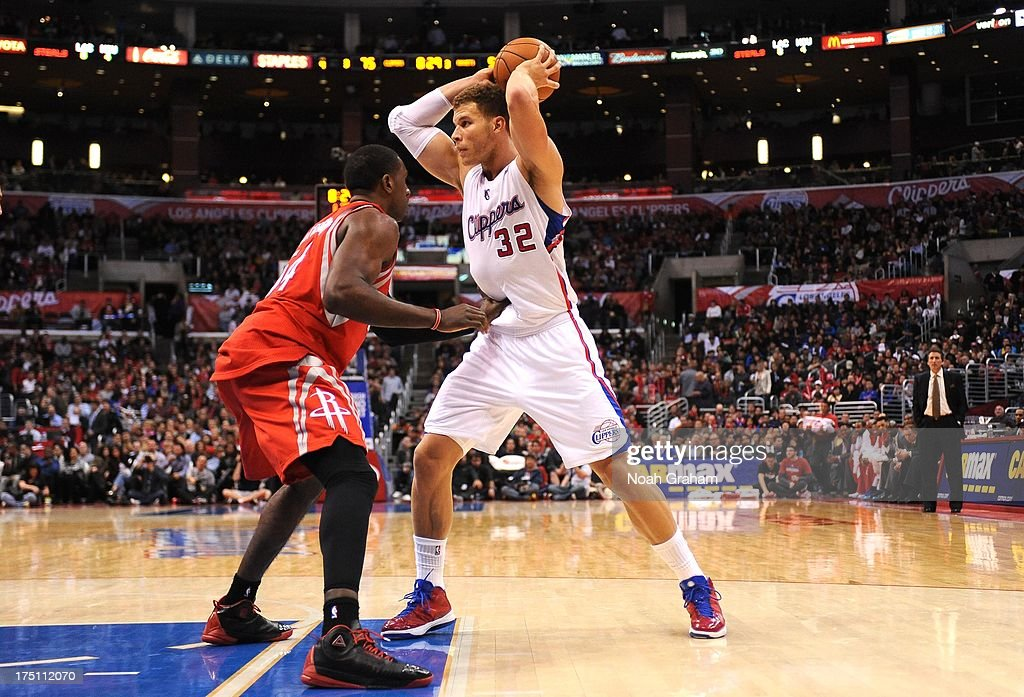 Blake Griffin #32 of the Los Angeles Clippers looks to pass over defense during the game between the Los Angeles Clippers and the Houston Rockets at Staples Center on February 13, 2013 in Los Angeles, California.